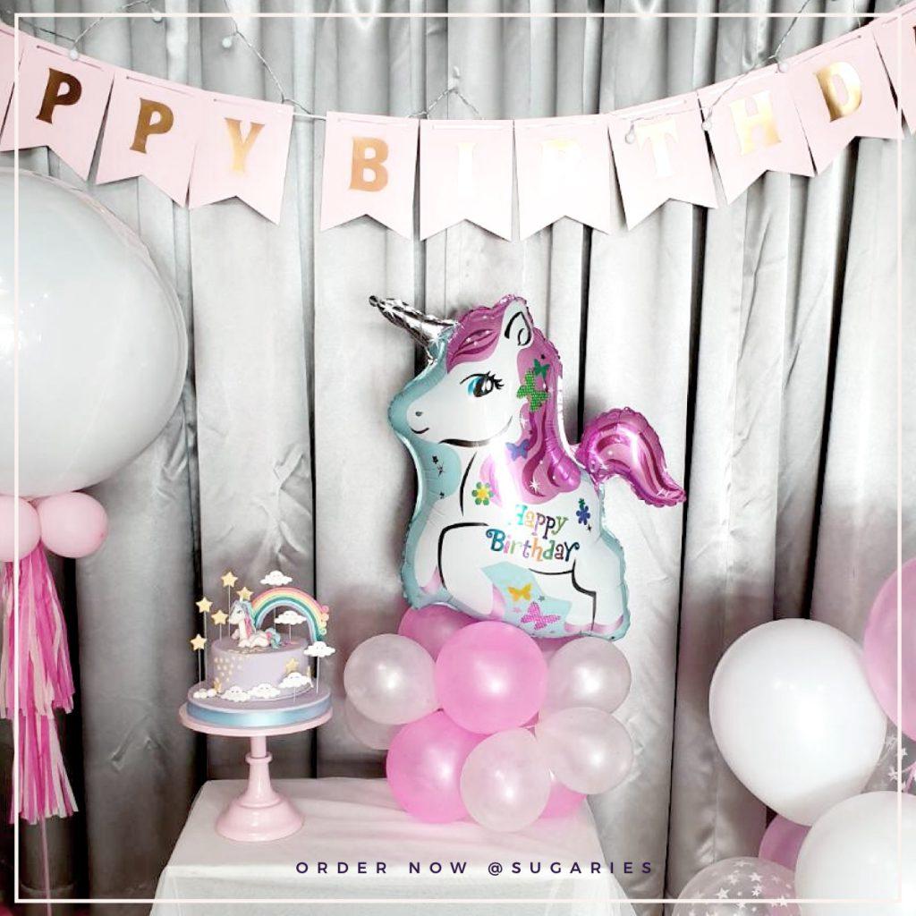 pony cake and balloon